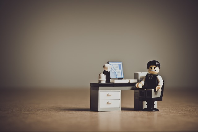 worried lego character at computer