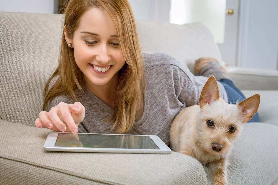 Woman and dog on iPad