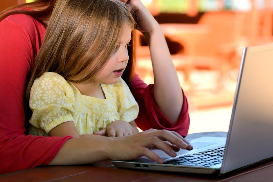 child and parent on a computer