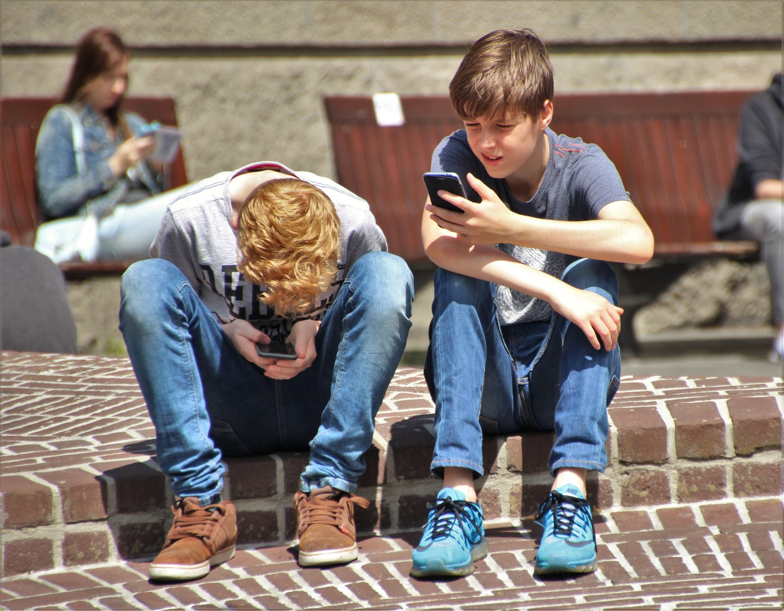 Two kids with cell phones